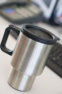 Shot of a reusable coffee cup on a desk