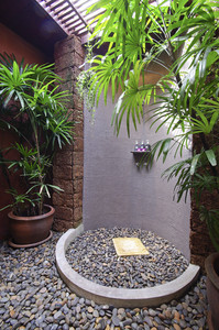 Shower room with stone on the floor