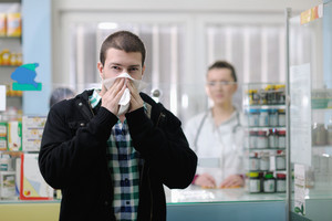 Sick man in pharmacy