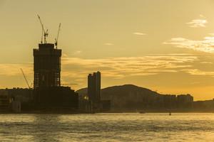 Silhouette construction sunrise asian skyline.