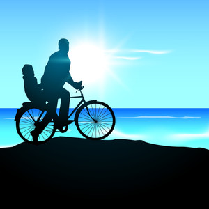 Silhouette Of A Father And His Child Go For Cycle Ride