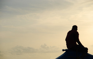 Silhouette Of A Fisherman On A Typical Dhoni Boat (sunset)