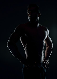 Silhouette of a handsome muscular man