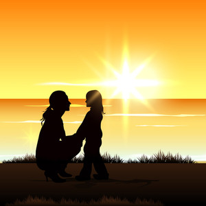 Silhouette Of A Mom With Her Child At Seaside