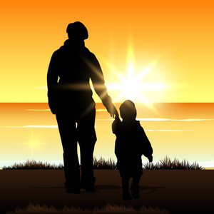 Silhouette Of A Mother With Her Child On Evening Background