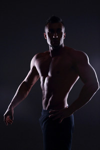 Silhouette of a muscular man