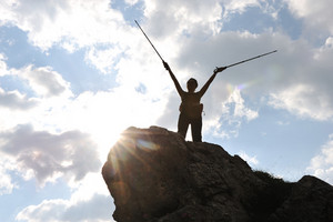 Silhouette of a woman during and adventage climbing and mountain walking