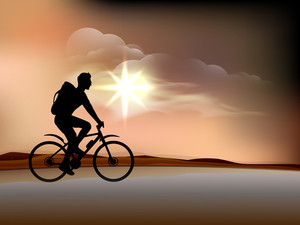Silhouette Of Bmx Cyclist In Evening Background.