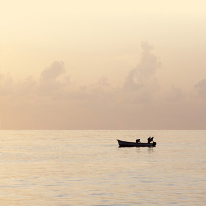 Silhouette of boaters at dawn