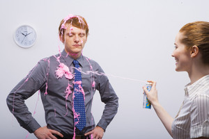 Silly string on businessman