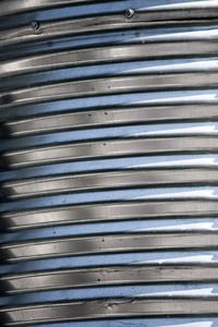 Silver galvanized metal with a corrugated texture.