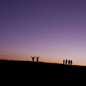 six children jumping for joy on mountain silhouette sunset