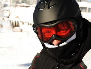 Skier with helmet on head