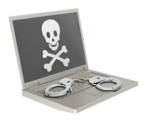 Skull And Crossbones On The Laptop Screen With Handcuffs.