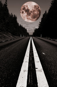 small country road with a full moon