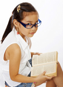 Small Girl Reading A Text Book