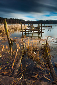Small pier on lake beautiful long exposure photo. Mazury lake district.