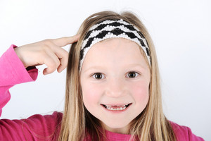 Smart blonde little girl smiling