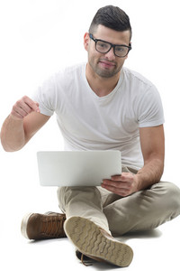 Smart looking man pointing to his laptop computer