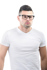 Smart looking young man with glasses isolated on white