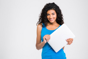 Smiling afro american woman holding laptop