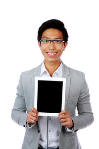 Smiling asian man showing tablet computer screen over white background