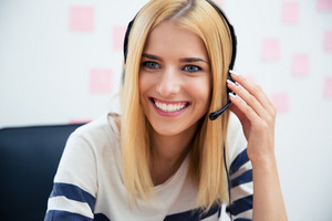Smiling beautiful girl with headset