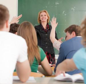 Smiling blonde teacher in a classroom