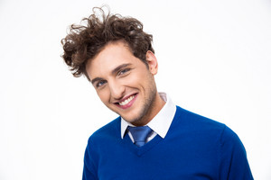 Smiling business man with curly hair looking at the camera