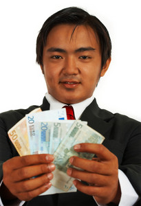 Smiling Businessman Holding Euros