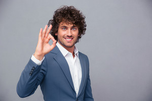 Smiling businessman showing ok sign