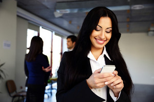 Smiling businesswoman using smartphone