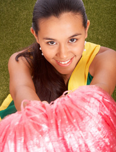 Smiling Cheerleader With Her Pom Poms