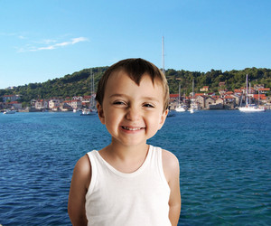 Smiling cute kid on sea shore
