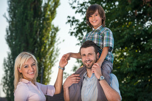 Smiling family posing outdoors in nature