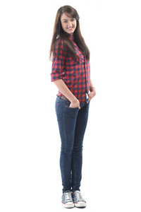 Smiling girl in black-red checkered shirt posing