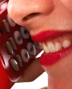 Smiling Girl On The Telephone