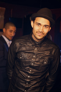 Smiling guy in black at the bar
