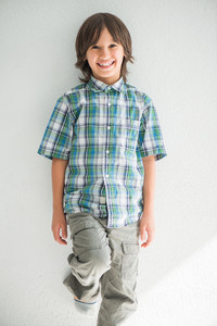 Smiling kid posing on a white background