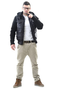Smiling male model in black jacket posing isolated on white