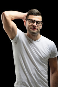 Smiling male model with glasses in white shirt