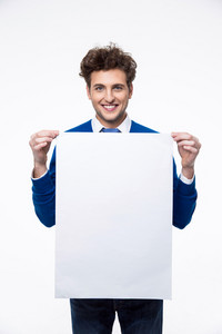 Smiling man holding empty paper and looking at camera
