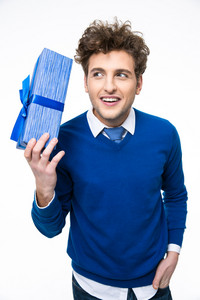 Smiling man holding gift over white background