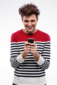Smiling man using smartphone over gray background