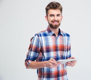 Smiling man using tablet computer