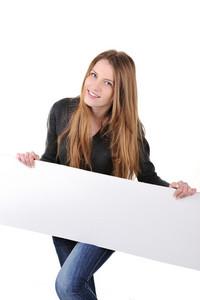 Smiling teenage girl holding white banner