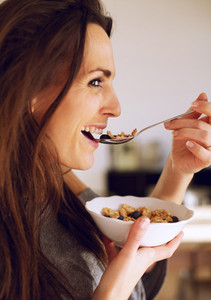 Smiling Woman Eating a Healthy Breakfast