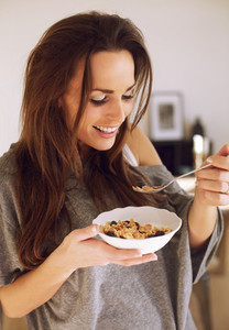 Smiling Woman Enjoying Her Breakfast