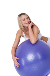 Smiling woman with purple ball on white background