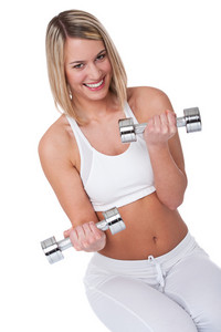Smiling woman with weights on white background